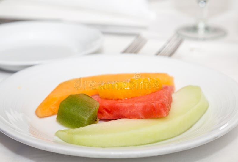 Meloenensinaasappel en Kiwi stock foto's