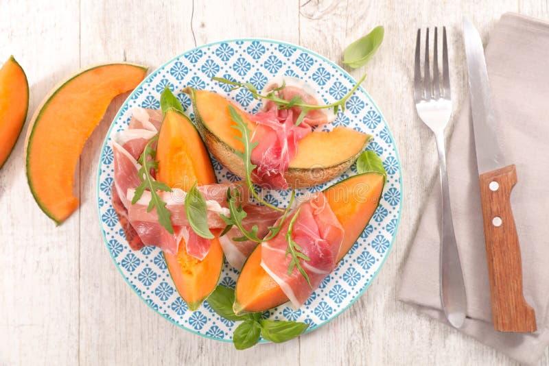 Melonów plasterki i prosciutto baleron obraz stock