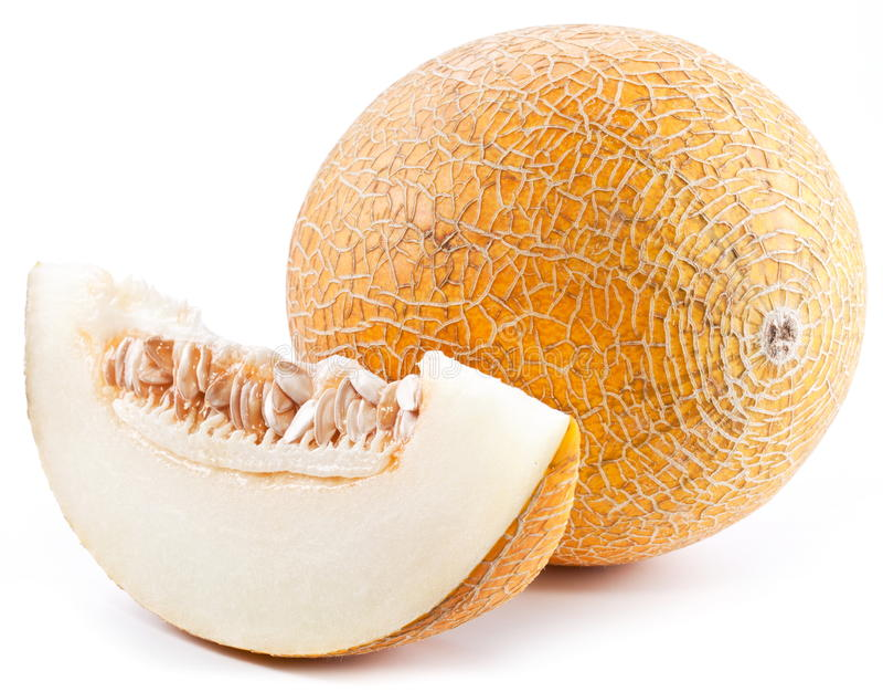 Melon avec des parts et des lames photographie stock