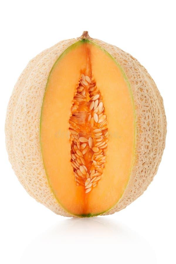 Melon de cantaloup coupé sur le blanc image stock