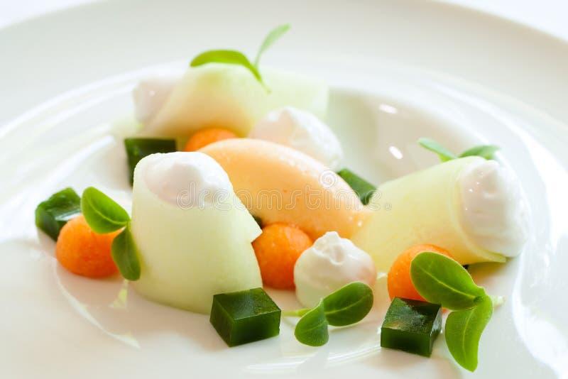 Melon dessert with multiple textures. stock photos