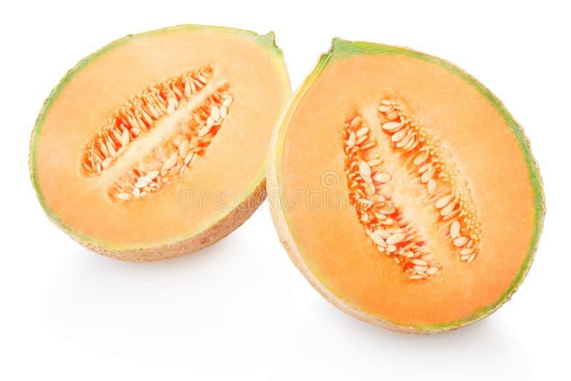 Melon et section de cantaloup sur le blanc photographie stock