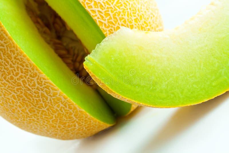 Melon honeydew and melon slice. Ripe fresh melon honeydew and a slice close-up royalty free stock image