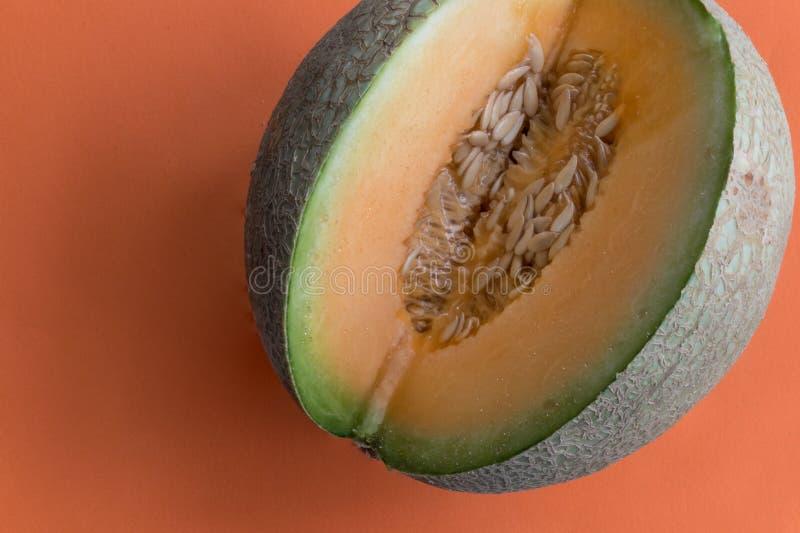 Cantaloupe, aka melon wedge on white background stock image