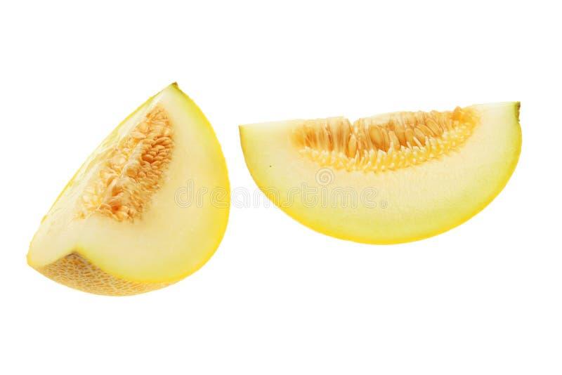 Melon segments. Isolated against white stock photos