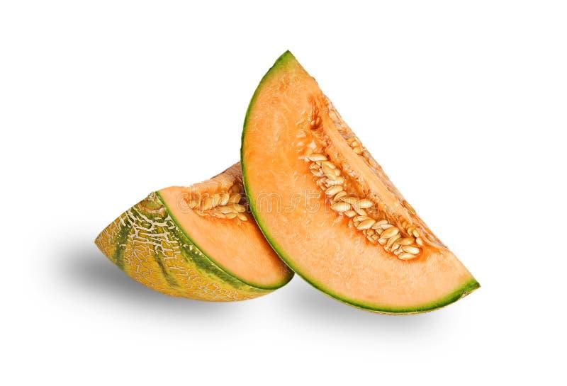 Melon segments. Isolated on white background stock images