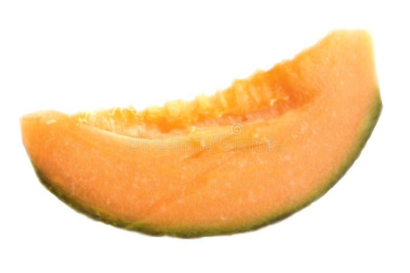 Melon slice. Cantaloupe melon slice isolated on white background royalty free stock image
