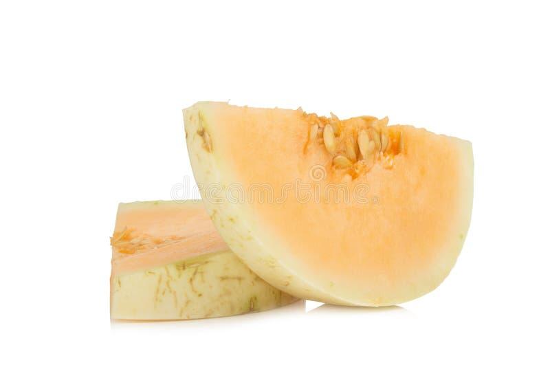 melon( sunlady) кусок половинно белизна изолированная предпосылкой стоковые изображения