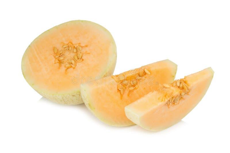 melon& x28; sunlady& x29; skiva half bakgrund isolerad white arkivbild