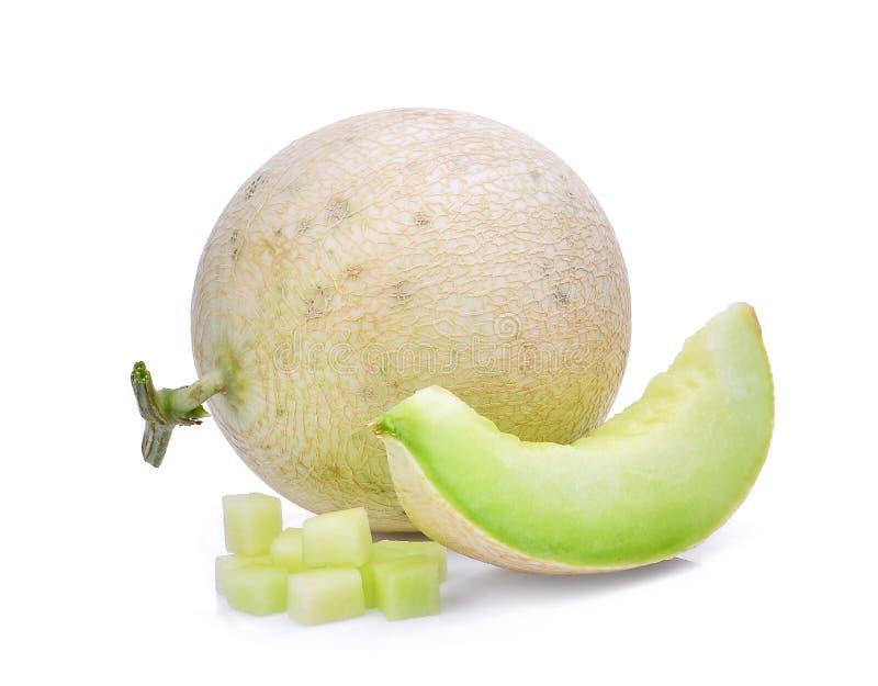 Melon vert de cantaloup avec des cubes d'isolement sur le blanc photos libres de droits