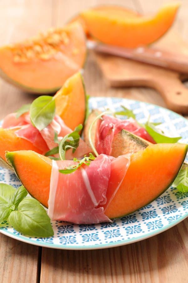 Melon?w plasterki i prosciutto baleron zdjęcie royalty free