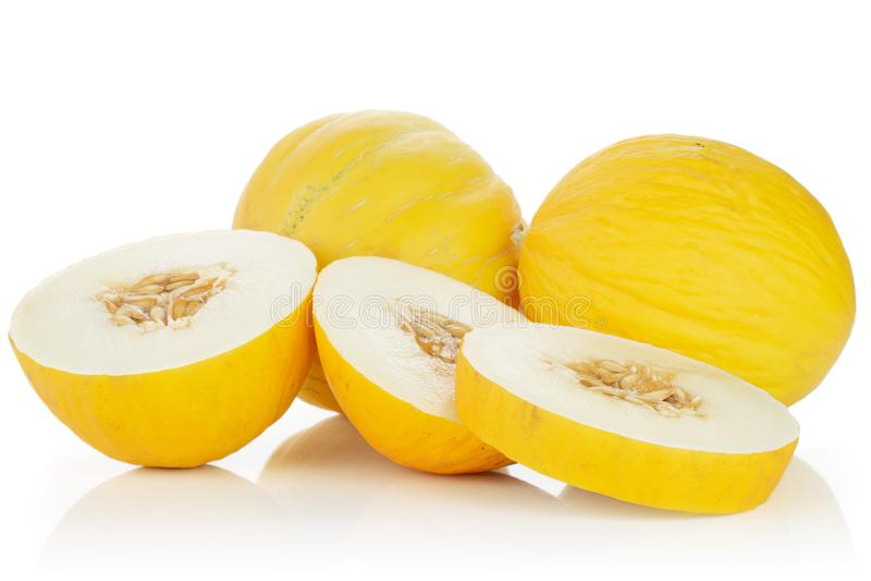 Melone color giallo canarino giallo isolato su bianco fotografie stock