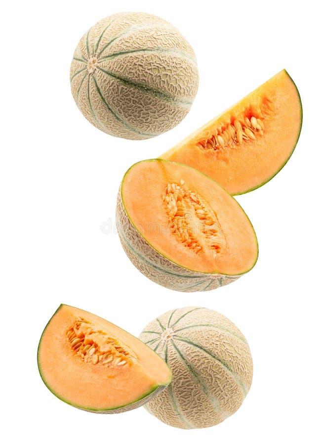 Melonen mit den Scheiben lokalisiert auf einem wei?en Hintergrund stockbild