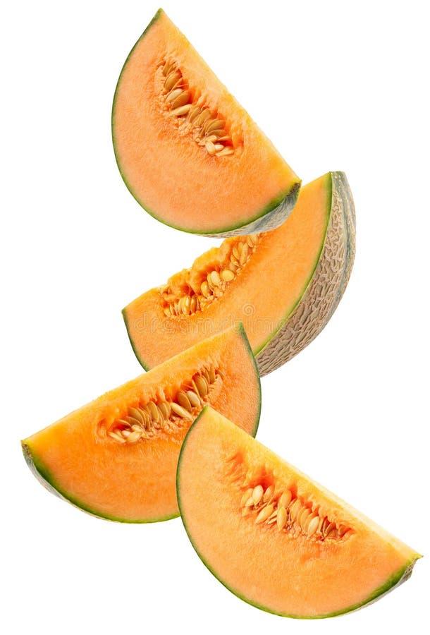 Melonenscheiben lokalisiert auf einem wei?en Hintergrund stockfotos