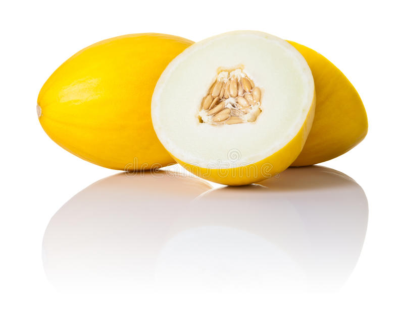 Melons. Two honeydew melons on white background. One sliced in half and second whole, copy space royalty free stock photo