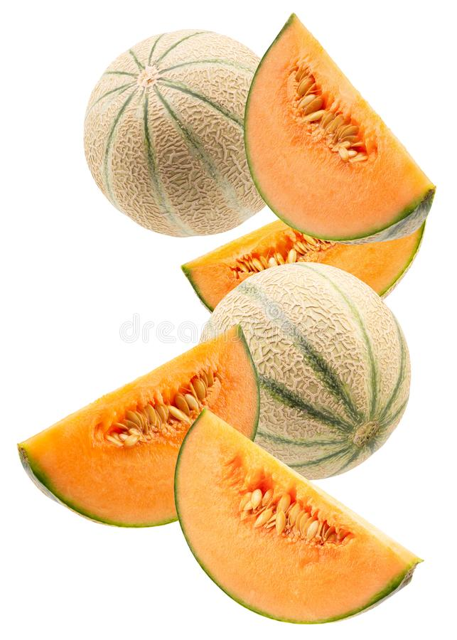 Melons with slices isolated on a white background royalty free stock photos