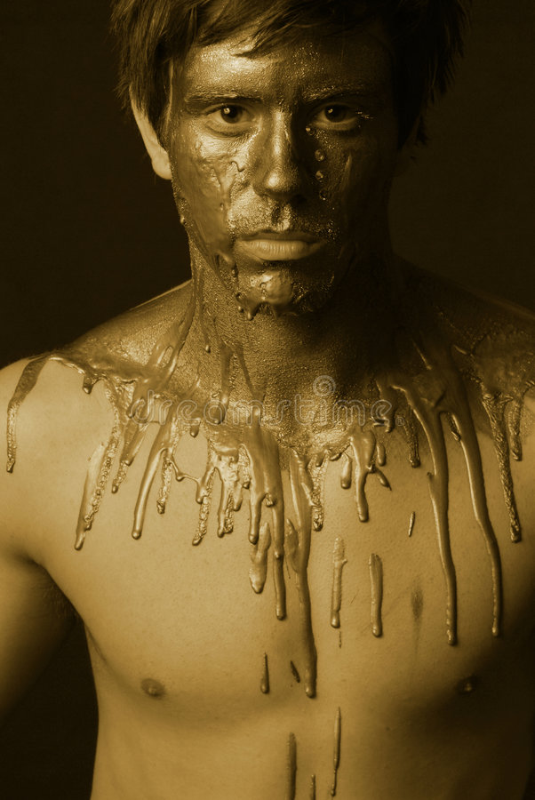 Melt down. Gold toned duotone mental melt down. male staring directly into the camera artistic portrait stock photo