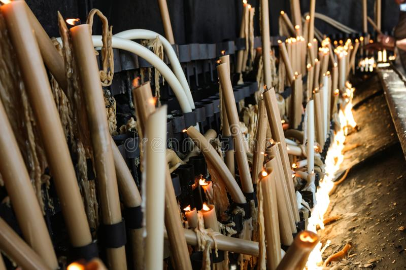 Melted candles in the city of Fatima Portugal. Candles lit as a sign of Christian faith stock images