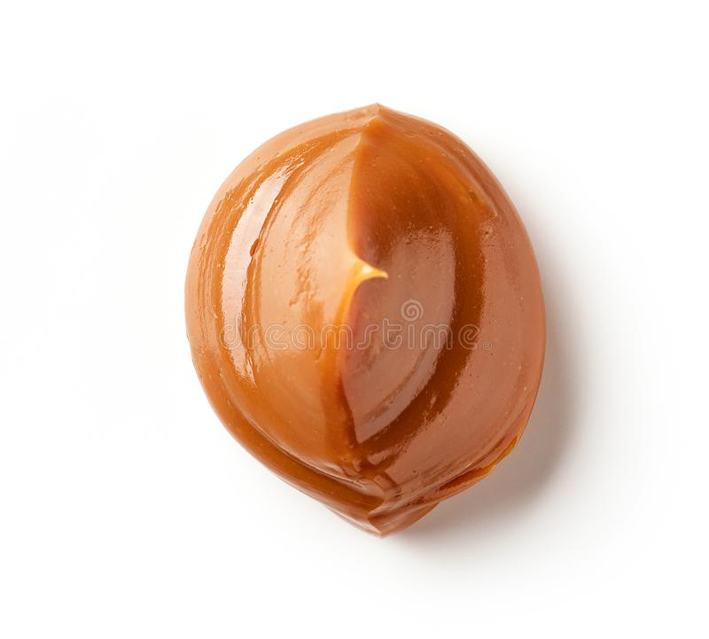 Melted caramel on a white background stock image