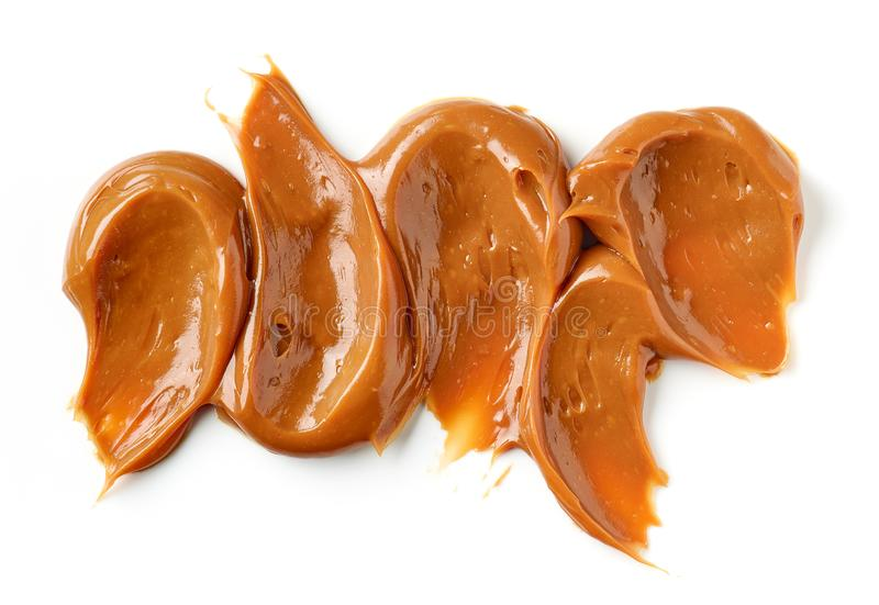 Melted caramel on a white background royalty free stock image