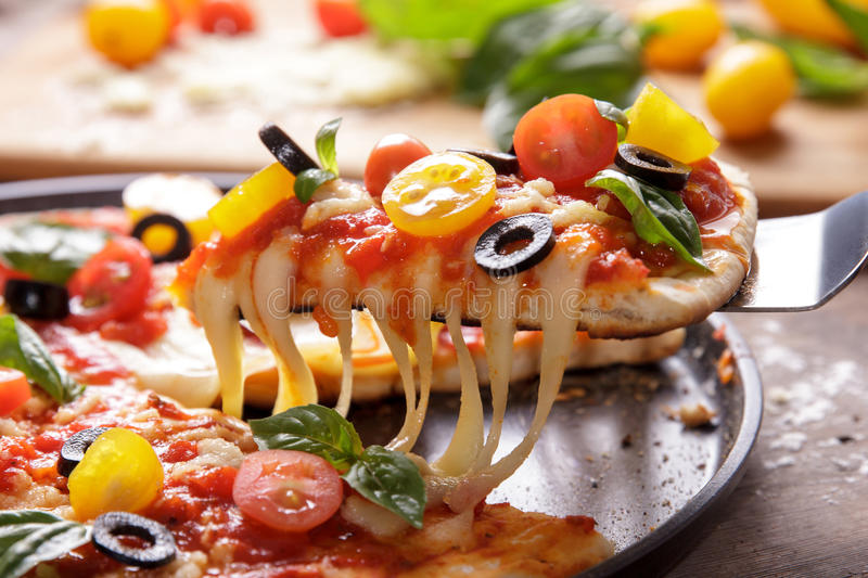Melted cheese on italian homemade pizza royalty free stock photos