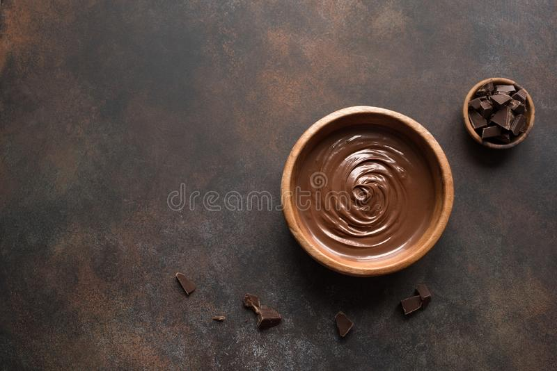 Melted Chocolate. Chocolate Spread on dark background, top view, copy space. Homemade melted chocolate in bowl stock image