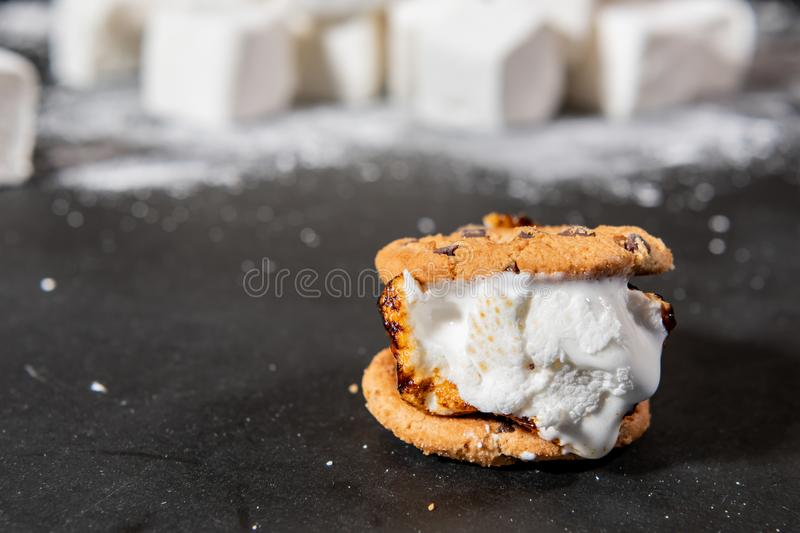 Melted Marshmallow Oozes from Cookie S'more stock photos