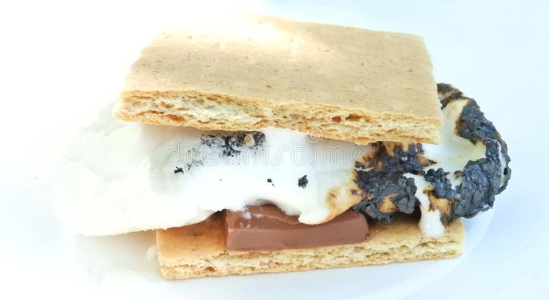 Melted marshmallow on S`More roasted treat stock photography