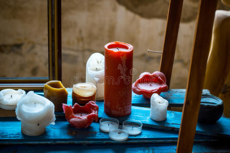 Melted paraffin candles stock images
