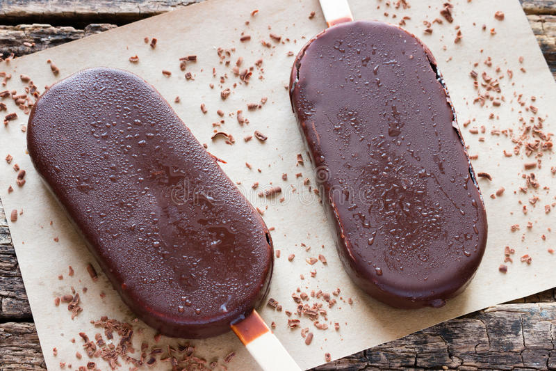 Melted popsicle. With grated chocolate royalty free stock images