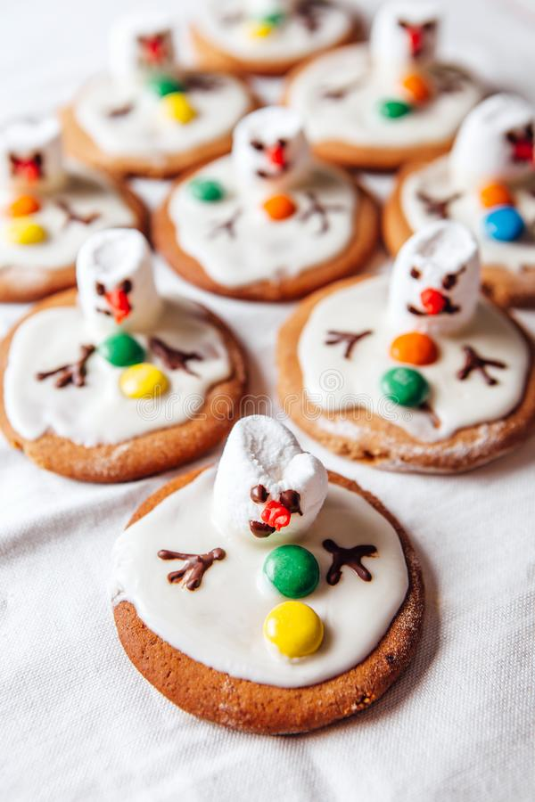 Melted snowmans - idea for decorating traditional ginger christmas cookies stock photo