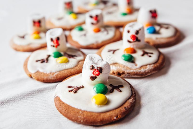 Melted snowmans traditional Christmas ginger cookies royalty free stock images