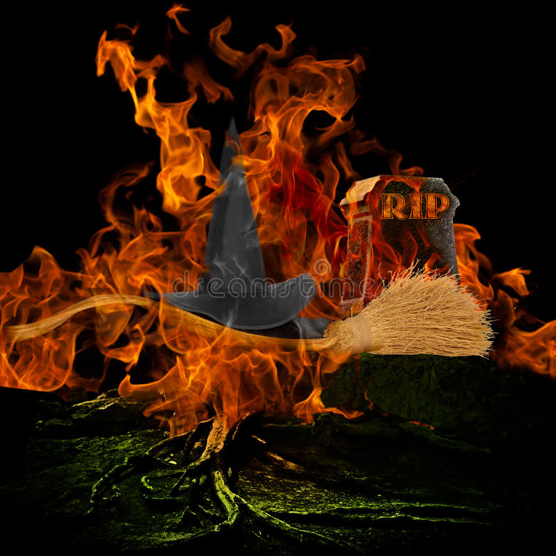 Melted Wicked Witch With Hat and Broom Stick Is Dead Spooky Scar. Y Graveyard With Burning Fire and Flames Engulfing Grave Stone With Rest In Peace RIP Evil stock images