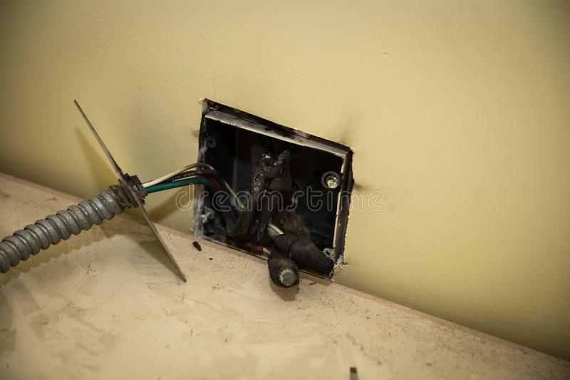 Melted wires after internal wall fire. Faulty wiring in the house caused a fire behind the wall. caused the wires to fuse together royalty free stock photos