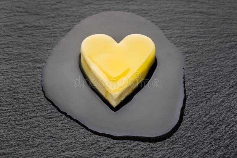 Melting butter heart stock photo