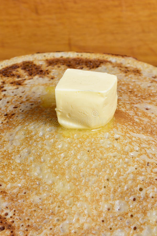 Melting butter pat on a pile of pancakes. Fried pancakes are usually roasted in all Orthodox families for the Orthodox holiday `Maslennitsa`. As a symbol of stock photography