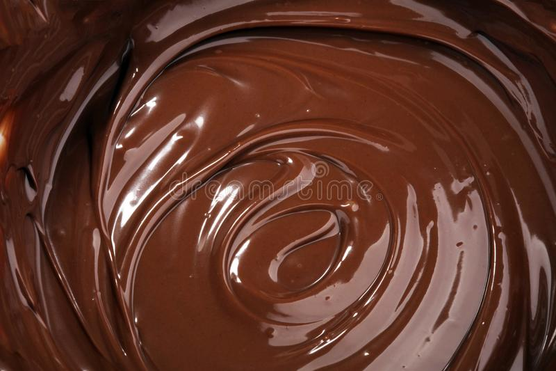 Melting chocolate, melted delicious chocolate for praline icing stock images