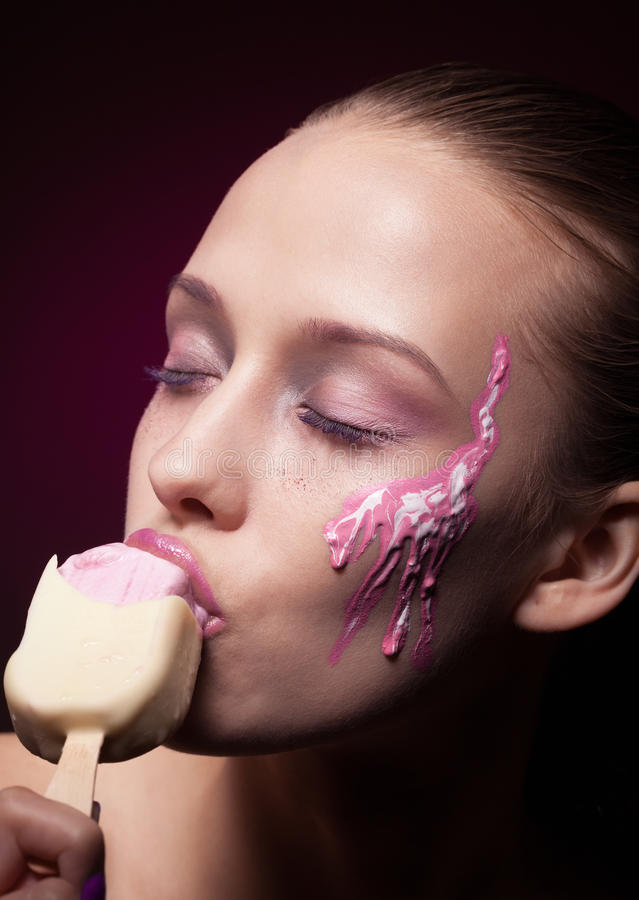 Melting down. Sensual woman with ice cream is melting down stock photos