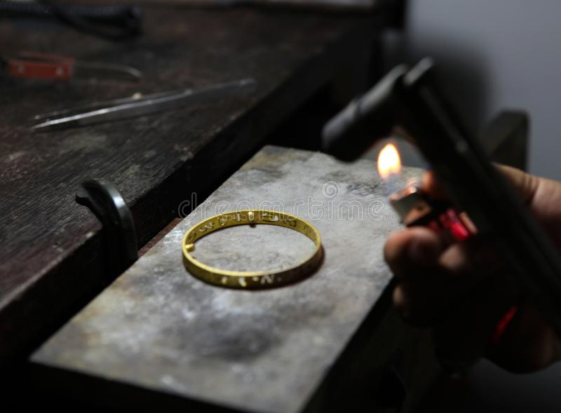 Melting gold jewelry by gas. stock photo