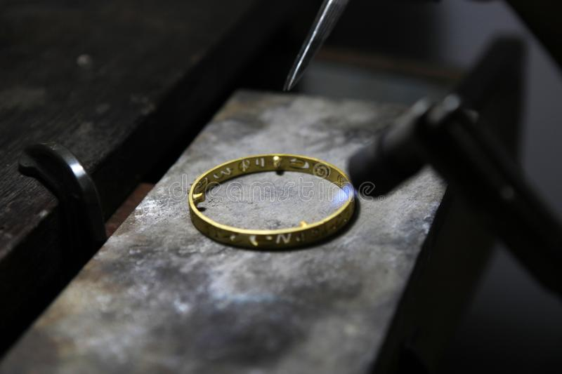 Melting gold jewelry by gas. stock images