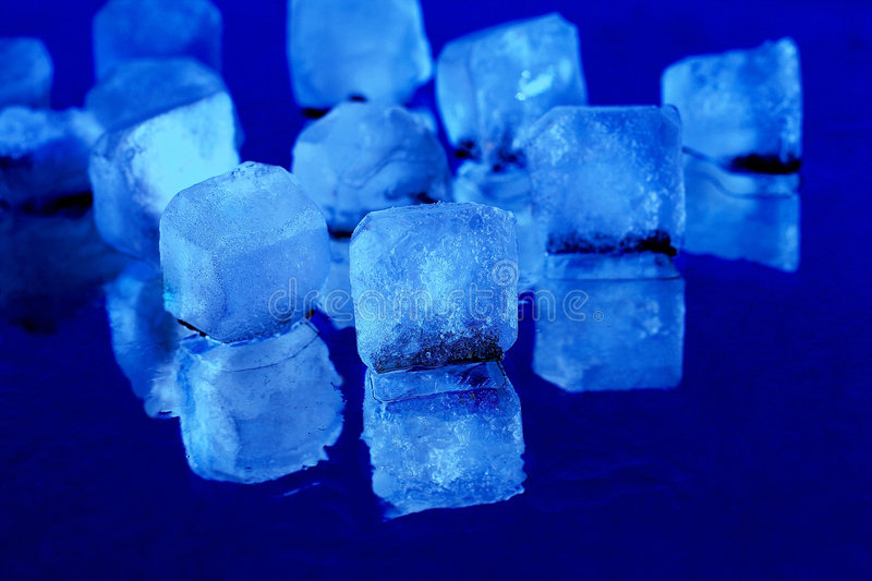 Ice. Cubes on a blue background royalty free stock images