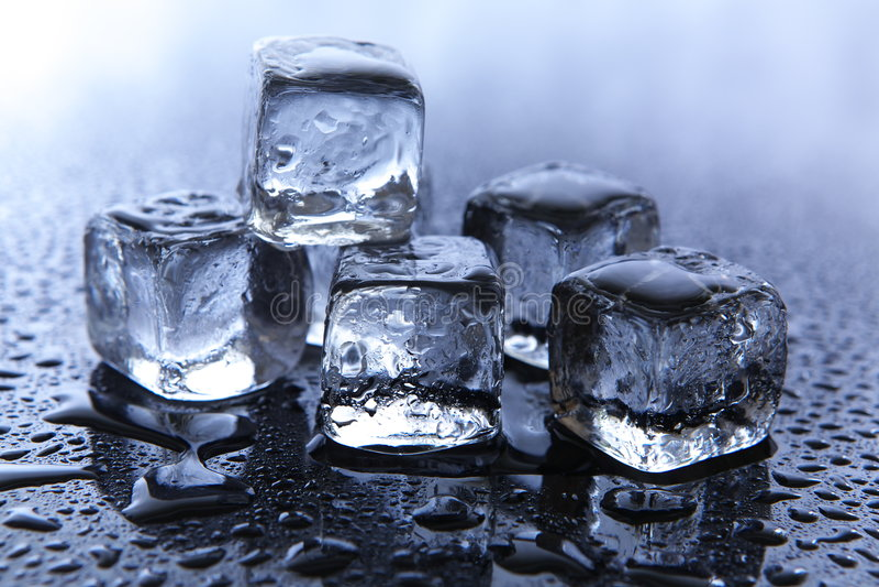 Melting ice cubes stock photos