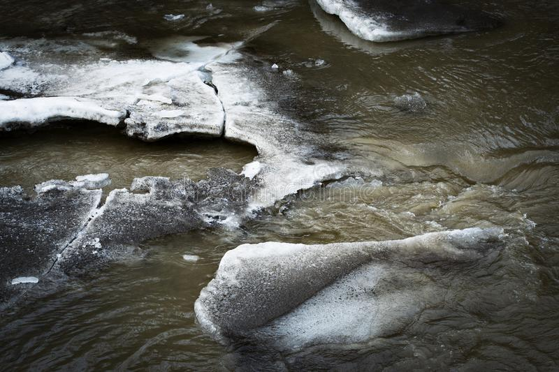 Melting ice floes on the river. Nature seasonal background melting ice floes on the river royalty free stock photography