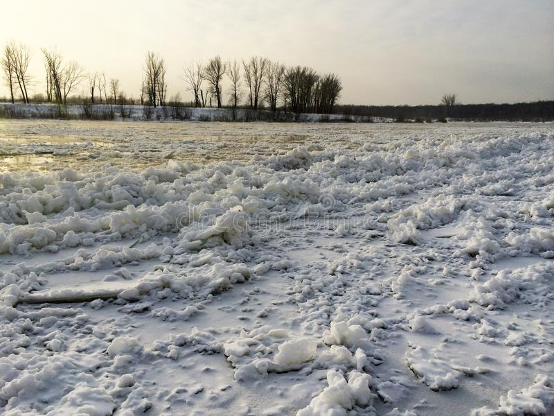 Melting of ice on the river, ice drift on the river in sun, early spring royalty free stock images