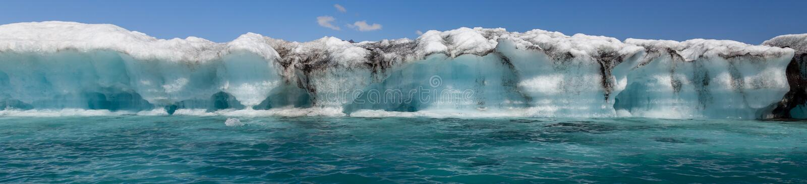 Melting Iceberg in Iceland, Climate Change Concept Panorama Web Banner. Panoramic climate change global warming concept, huge melting Icebergbreaking off the royalty free stock photos