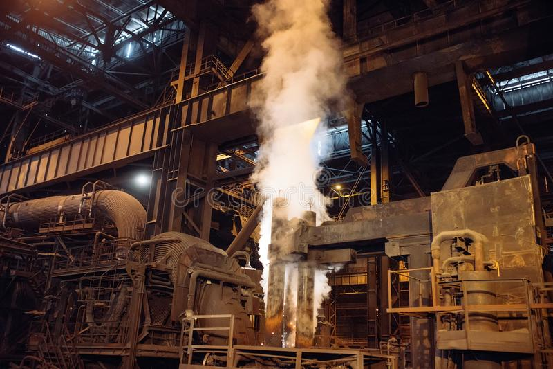 Melting of metal in a steel plant. Metallurgical industry. Melting of metal in a steel plant. Metallurgical industry royalty free stock image