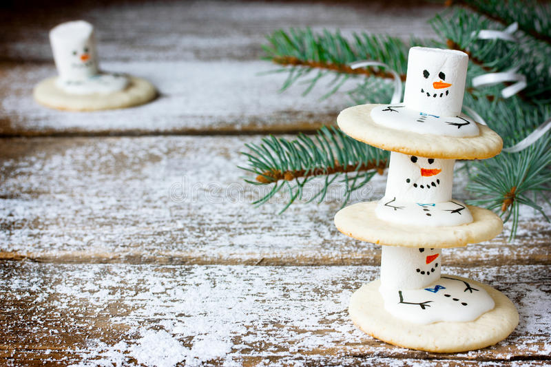 Melting snowmen cookies, funny idea for kids Christmas stock photography