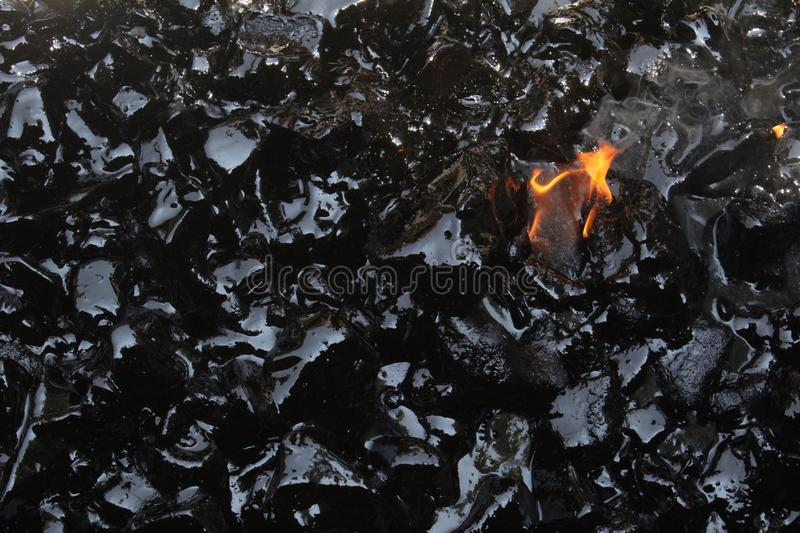 Melting tar. Tar is molten with fire in order to build a support for silver works stock photo
