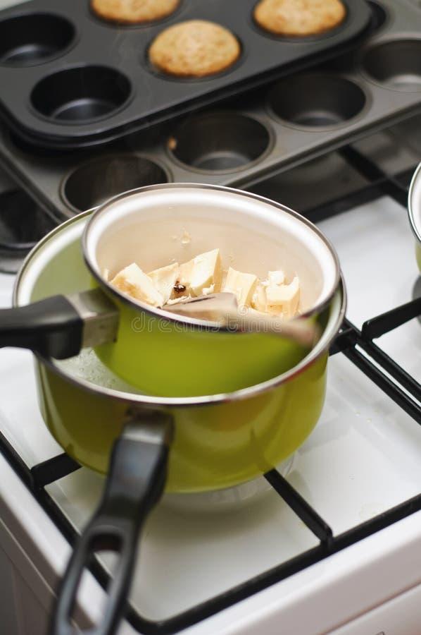 Melting white chocolate. Melting chocolate at bain marie stock image