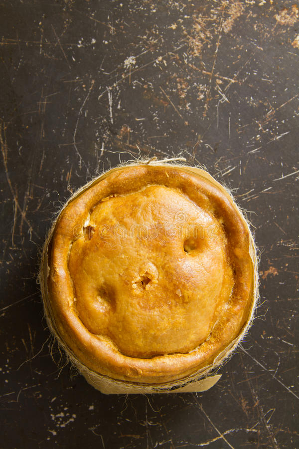 Melton Mowbray pork pie on distressed metal stock image